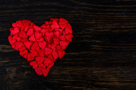 candy in the form of red hearts lie on the wood Stok Fotoğraf
