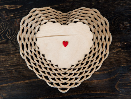 sweetmeats: small red heart lies on a large wooden