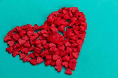 bosom: candy in the form of red hearts Stock Photo