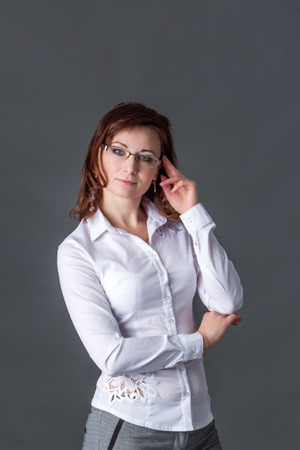 business woman in glasses and a white blouse
