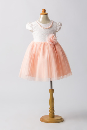 habiliment: baby pink dress on a mannequin, light gray background