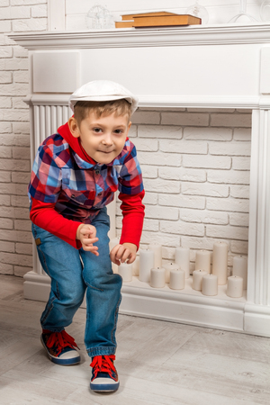 mantelpiece: little boy sneaks and looking at the camera