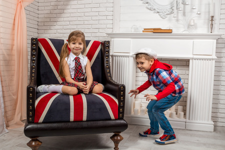 british girl: girl sitting on a chair with a British flag