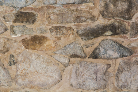 socle: plinth of gray and yellow decorative stone, close-up