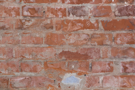old brick wall: texture of an old red brick wall
