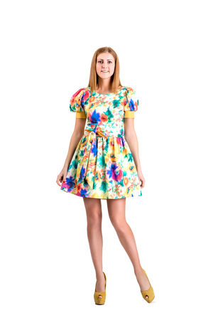 womankind: girl in a dress on a white background Stock Photo