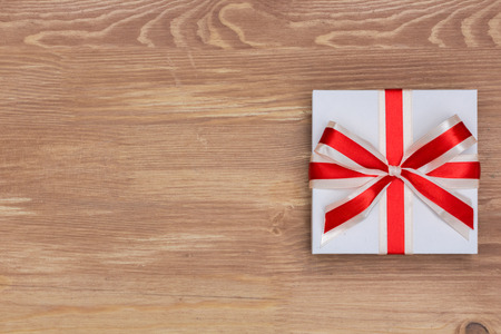 pledge: gift on a background of aged wood