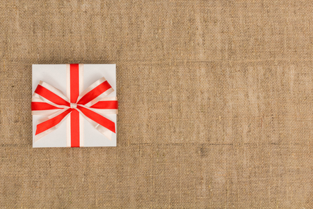 pledge: gift lays on burlap view from above Stock Photo