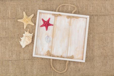 lashing: starfish and a wooden box lying on sacking, view from above