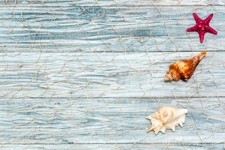lashing: Marine shell on white boards, flat lay Stock Photo