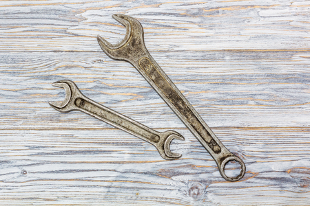 wrenches: flat lay: two wrenches on old boards