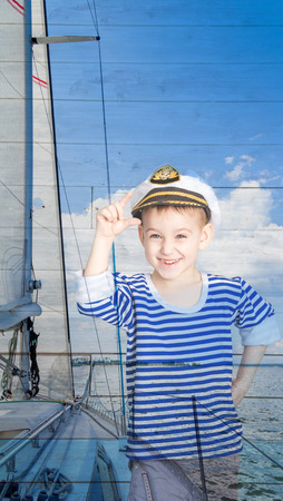 seaman: Double exposure a little boy seaman and yacht, closeup Stock Photo
