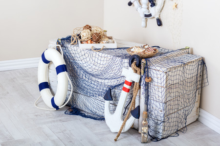 preserver: Marine elements of the interior: box, net, anchor and life preserver
