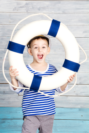 dido: little boy holding a life preserver and screaming, closeup