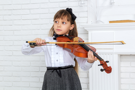 stringed: little girl playing the violin and looking away
