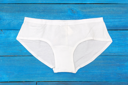 white panties: white panties lying on the aged boards Stock Photo