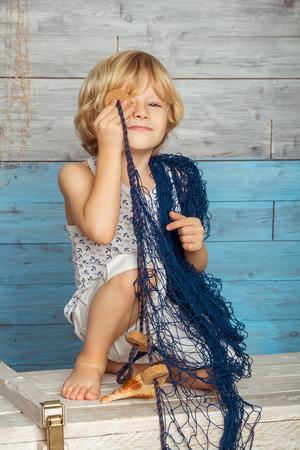 mischievous: mischievous little boy with a marine network