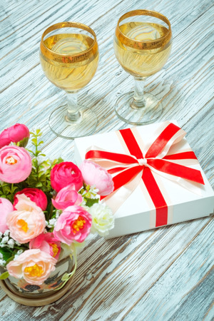 Two glasses of white wine flowers and a gift flat lay stock photo two glasses of white wine flowers and a gift flat lay stock photo picture and royalty free image image 57007452 mightylinksfo