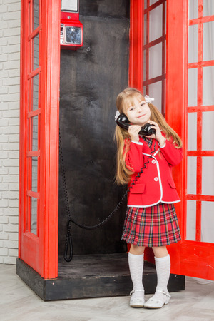 handset: little girl with handset, looking at camera