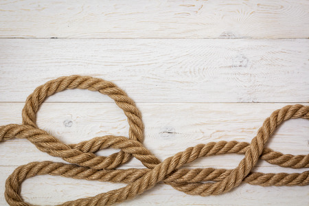 thick marine rope on white boards, copyspace