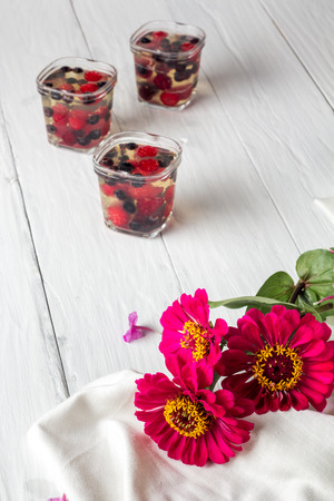 limpid: red flowers and on background jelly berries