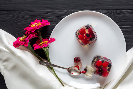 limpid: Berry jelly on plate and flowers top view