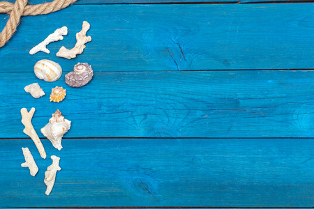 lashing: flat lay: seashells and rope on blue boards, copyspace Stock Photo