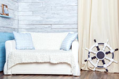 white sofa: white sofa with a steering wheel, interior Stock Photo