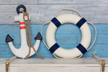 anchor and lifeline is on the background of aged wood Stock Photo