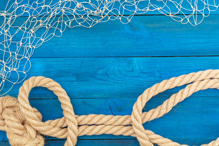 lashing: Marine Network and rope on blue boards, flat lay