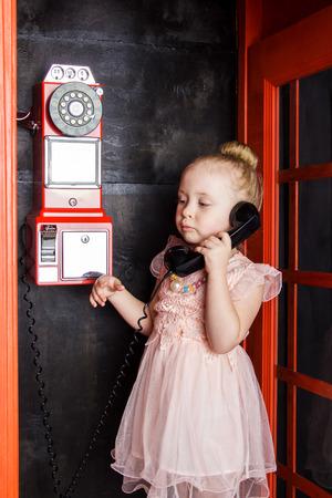 handset: Little girl with handset in hand, closeup