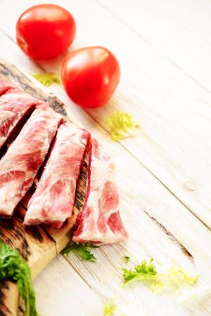 meaty: raw pork ribs on a cutting board, copyspace