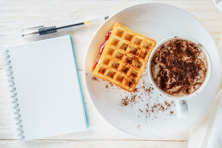 decaf: waffles with jam and cup cacao, flat lay
