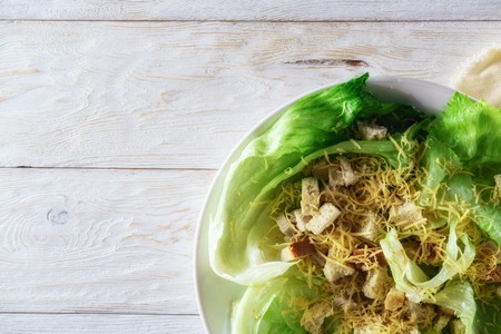 Caesar salad, with space for text. Flat lay