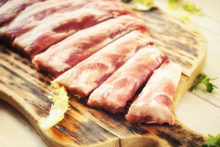 meaty: raw pork ribs on a cutting board, closeup