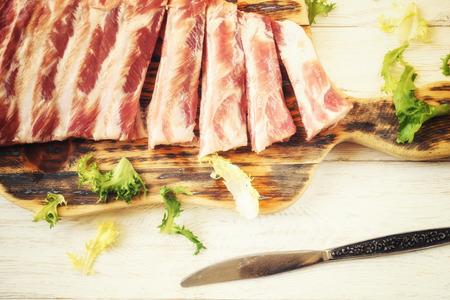 meaty: raw pork ribs on a cutting board, top view Stock Photo