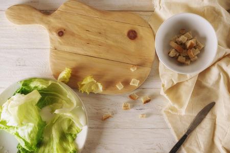 Prepare caesar salad, cut ingredients. Top view