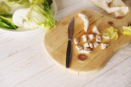 Prepare Caesar salad, cut ingredients. Close up