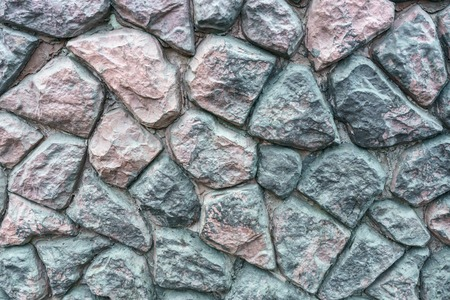 Texture of coarse artificial stone closeup. Copyspace