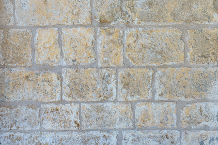 texture of wall from an old badly worked stone closeup