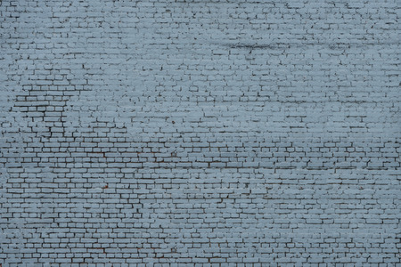 Texture of the brick wall of old blue brick