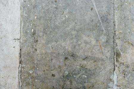 Gray texture old concrete wall with cracks Фото со стока