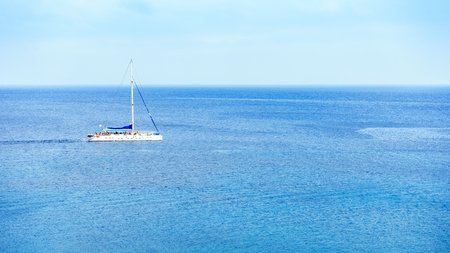 A sailing yacht sails in middle of sea. Cyprus