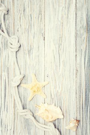 Starfish and seashell on a light wooden background Standard-Bild