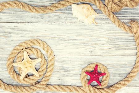 Starfish and seashell on a light boards Standard-Bild