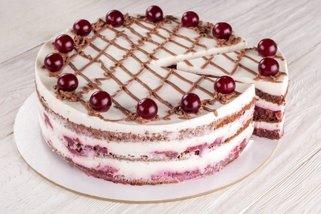 Chocolate cake with mousse, decorated cherries Standard-Bild