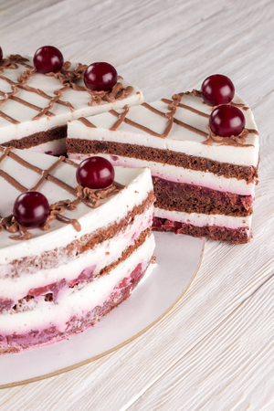Chocolate cake with mousse, decorated cherries Stok Fotoğraf