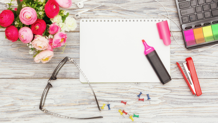 stationery, flowers and notepad Archivio Fotografico