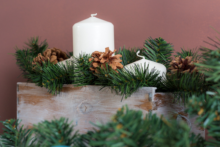 Candle box decorated with fir branches and pine cones Archivio Fotografico