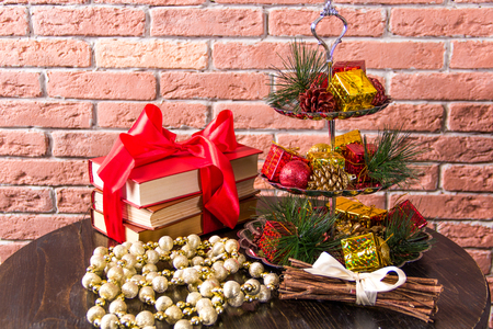 Christmas decorations and books on a wooden table Archivio Fotografico